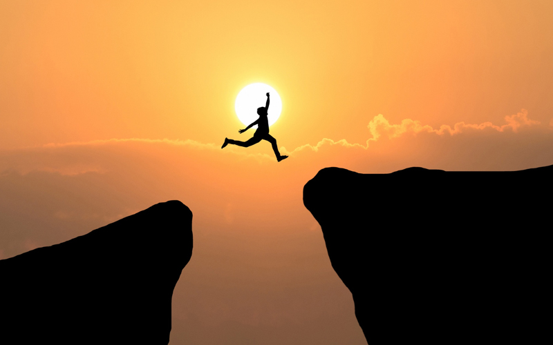 courage-man-jump-through-the-gap-between-hill-business-concept-idea2