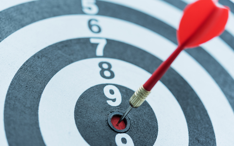 dart-target-arrow-hitting-on-bullseye-with-sun-light2
